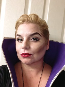 Make up for Maleficent - high brows, stark cheekbones and red lips.